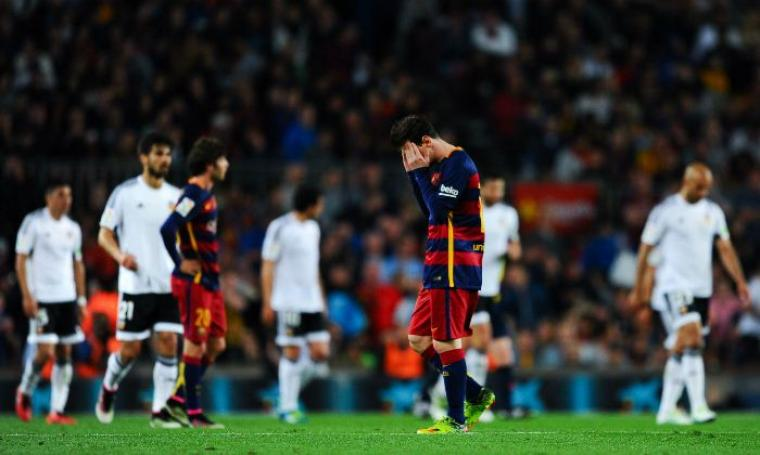 Kekalahan 2-1 dari Valencia membuat pemain Barcelona frustasi. (Dok:net)