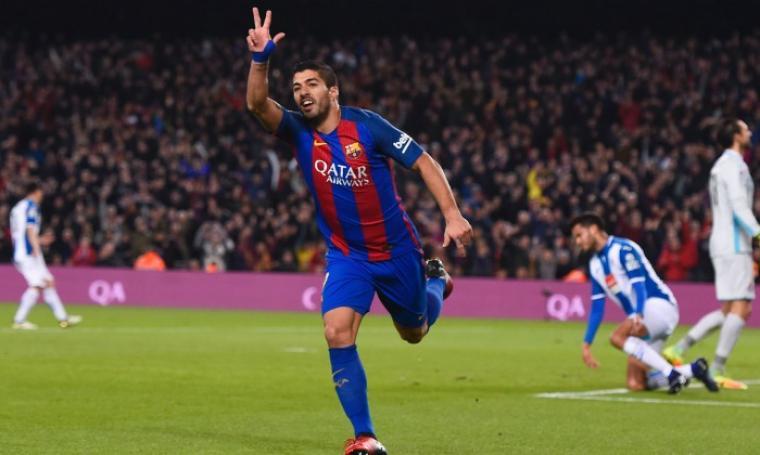 Selebrasi Luis Suarez usai mencetak gol. (Dok: Goal.com)
