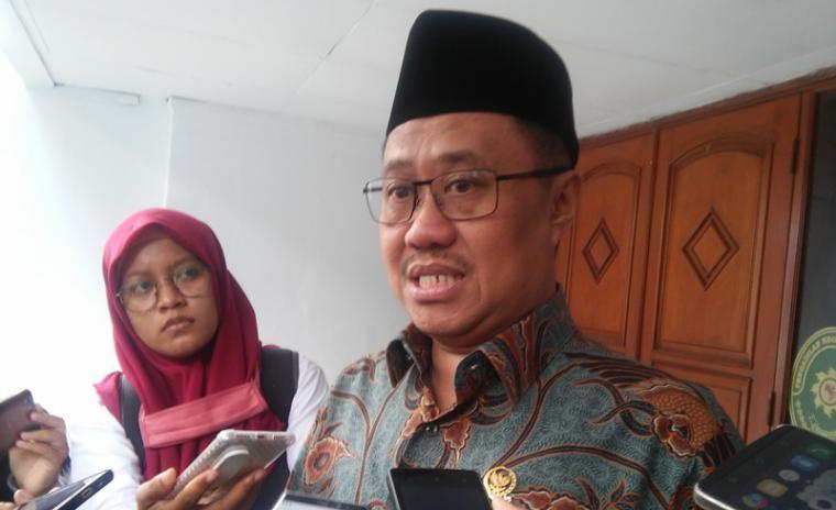 Ketua Komisi Yudisial (KY) Aidul Fitriciada Azhari saat memberikan keterangan. (Foto: TitikNOL)