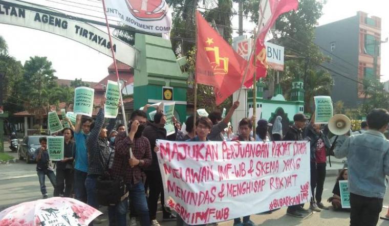 Aksi mahasiswa Banten menolak Annual Meeting IMF - World Bank di Bali pada 8-14 Oktober 2018. (Foto: TitikNOL)