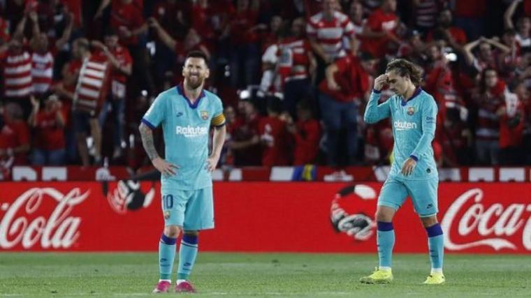 Lionel Messi dan Antoine Griezmann. (Dok: Cnnindonesia)