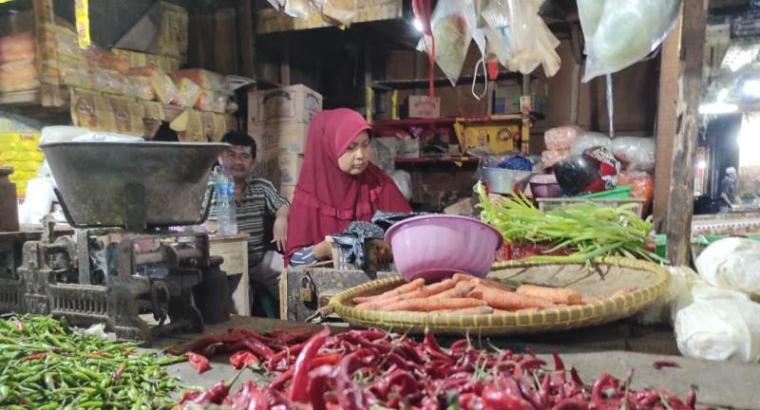 Salah satu penjual sayuran di Pasar Induk Rau Kota Serang. (Foto: TitikNOL)